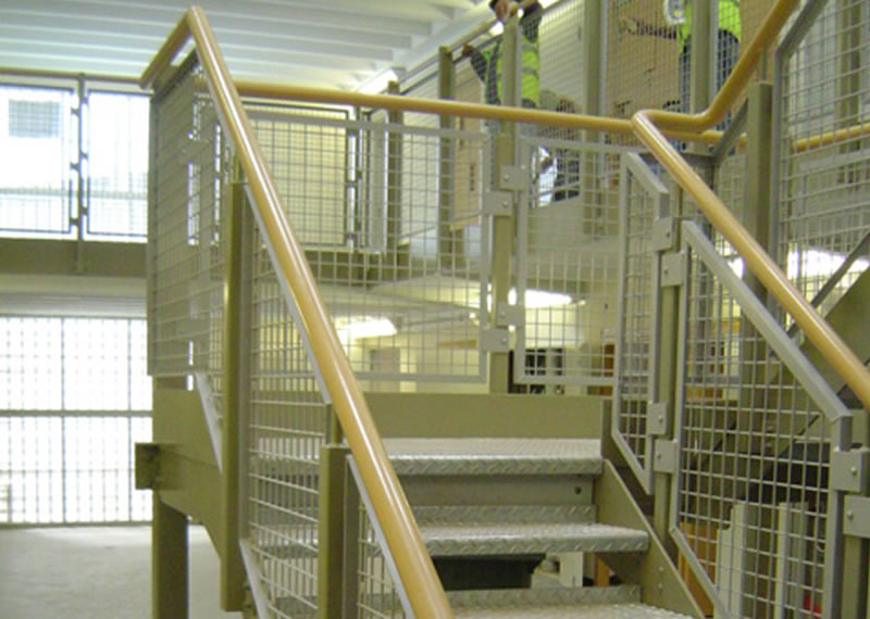 Painted mild steel staircase and balustrade to Her Majesty Prison at Nottingham UK