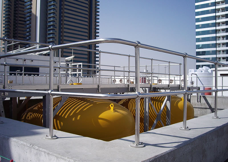 Polished stainless steel handrails around surge vessels to Qatar Pumping Station